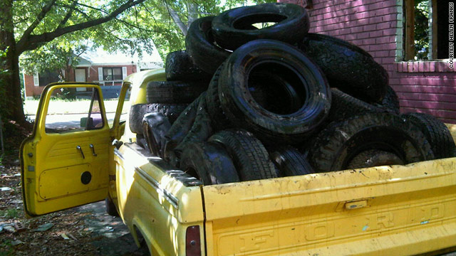 A truck loaded with tires found behind a vacant house is ready to head to the tire collection point in Atlanta.