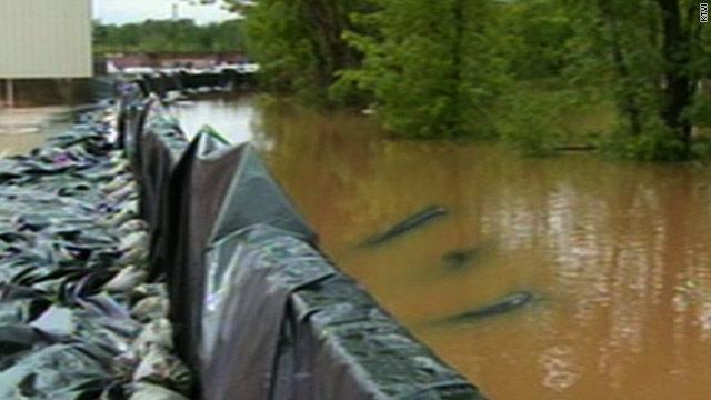 Flood evacuations in Midwest, tornadoes in Arkansas