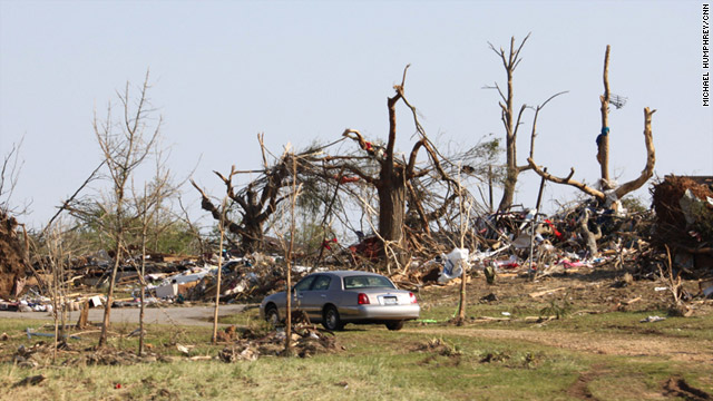 Destroyed trees and piles of debris are all that remain in Hackleburg, Alabama after a devastating storm.