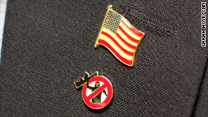 "Johnny Spann wears two lapel pins: an American flag and a ""fight terror"" badge."