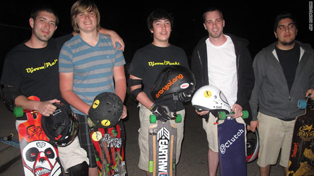 Skaters Ryan Lowery, Parker Sands, Brandon Lowery, Brandon Pippert,  and Ara Sarkissian practice downhill long-board racing at night.  (by Jim Roope/CNN)