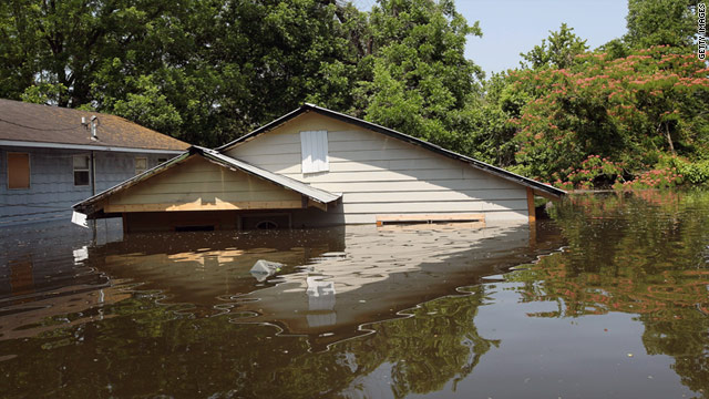 Water nearly covers a home Thursday in Vicksburg, Mississippi, where 600 residents had been evacuated as of Thursday night.
