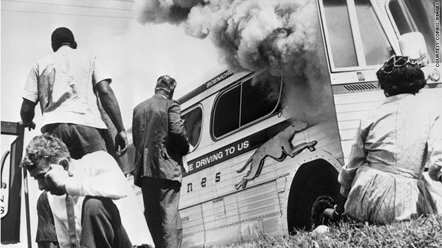 Freedom Riders flee a bus burned by an Alabama mob in 1961. The group now has a new fan base -- Arab protest leaders.