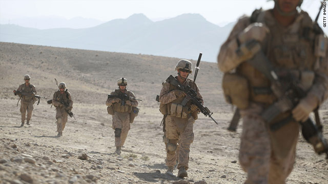 U.S. Marines patrol the outskirts of a village near a forward operating base near Kajaki, Afghanistan, in October.