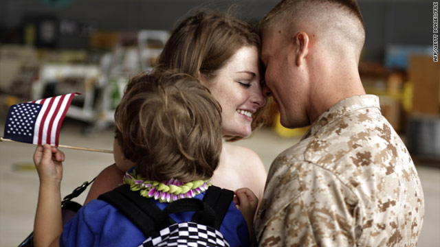 Savannah Dejong, with son Rhone, 3, greets her husband, Daniel, in Hawaii after his seven-month deployment to Afghanistan.