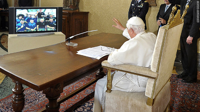 Pope Benedict XVI waves to astronauts during his video conference Saturday at the Vatican.