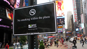 A no smoking sign is posted in the pedestrian plaza in Times Square.