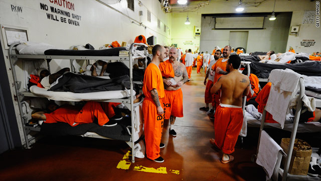 Inmates at Chino State Prison, which houses 5,500 inmates, crowd around the double and triple bunk beds.