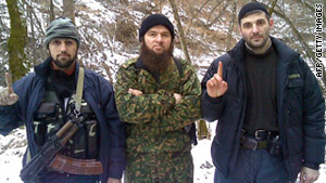 An undated picture allegedly shows Chechen rebel Doku Umarov, center, with two unidentified fighters.