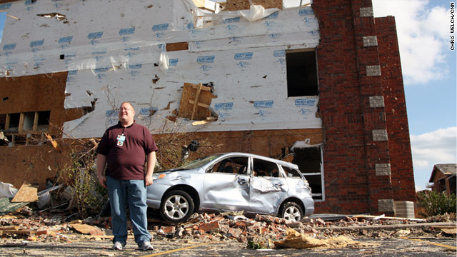 Stephen McCullough, a crisis counselor in Joplin, Missouri, shows where a car flew into the side of the building where he lived.