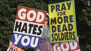 Westboro Baptist Church members protest with unsettling signs (image courtesy of CNN.com)
