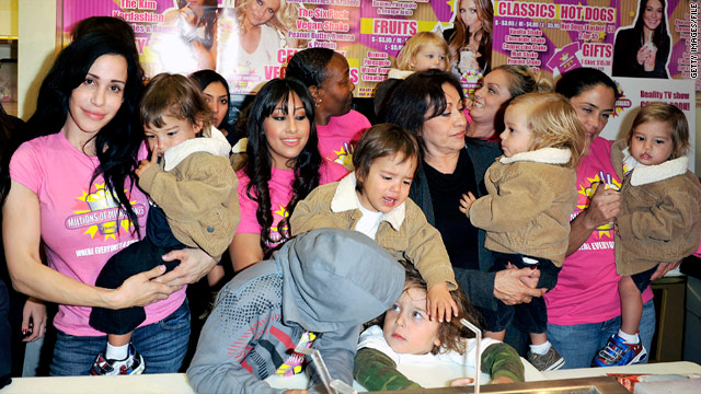 "Nadya Suleman, left, launches a signature milkshake at ""Millions of Milkshakes"" with her family and their helpers in 2010."
