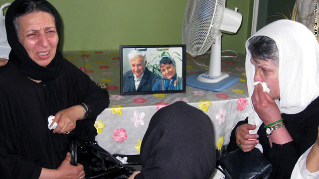Relatives mourn next to a photo of Iranian opposition figure Ezatollah Sahabi and his daughter Haleh Sahabi.