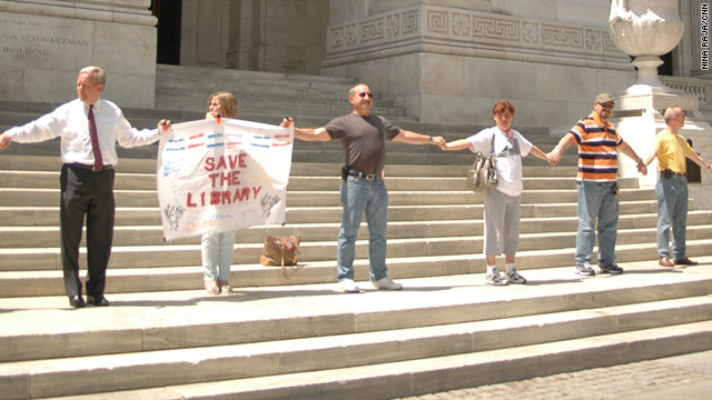 Saturday's human chain at the 42nd Street branch was part of a nationwide campaign against funding cuts for public libraries.