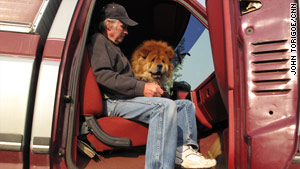 Bob Meador, with his 18-year-old dog Tigger, prepares to evacuate his home as the Wallow Fire gets closer.