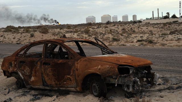 A charred car sits near an oil terminal in the section of eastern Libya now held by the Transitional National Council.