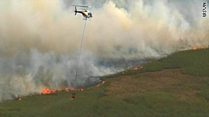 The fire has burned more than 33,500 acres west of Miami, Florida.