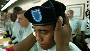 An Army recruit in his third week of basic training is fitted with a beret at Fort Jackson, South Carolina.