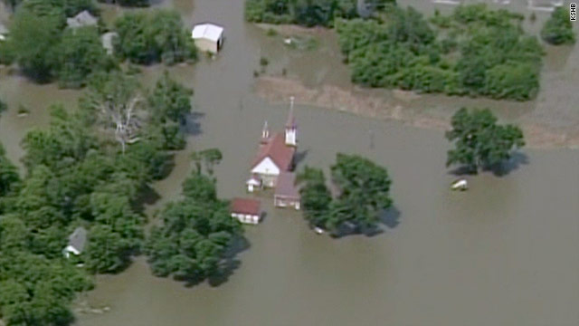 The Missouri River broke through levees at two points early Sunday, causing more resident evacuations.