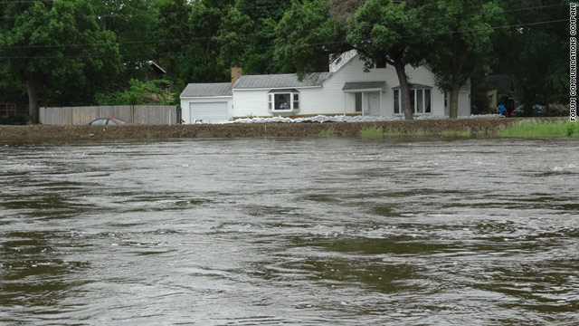 The swollen Souris River flows straight through Minot and is expected to overwhelm area levees.