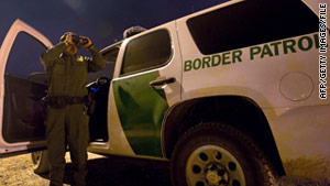 A Border Patrol officer searches for illegal immigrants in El Paso, Texas.