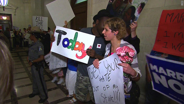 Crowds in Albany, New York, chant both for and against a bill that would hlep legalize same-sex marriage in New York.