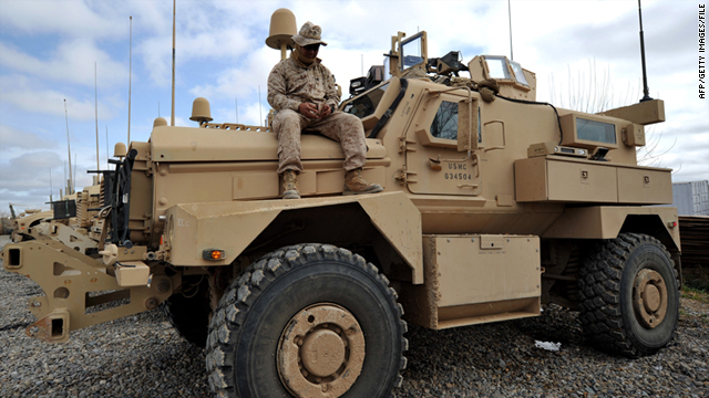 A U.S. Marine sits on a Mine-Resistant Ambush Protected Vehicle in Helmand Province, Afghanistan, on March 2.