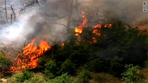A wildfire burns in McLoud, Oklahoma, on Friday. Officials say more than 10 fires are burning across the state.