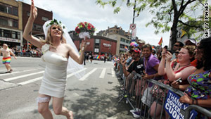 Gay rights supporters take part in New York's pride parade on Sunday, two days after the state legalized same-sex marriage.