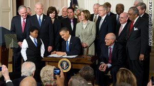 Lawmakers surround President Barack Obama as he signs the health care legislation in March 2010 at the White House.