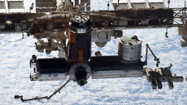 As debris neared, NASA ordered the six crew members to take shelter aboard the two Soyuz capsules, a spokesman said.