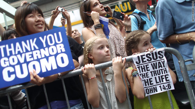 Signs for and against New York's same-sex marriage law were displayed Sunday at the Gay Pride parade.