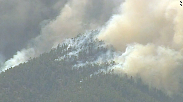Smoke billows from the Las Conchas fire, which began on June 26 and expanded into the Santa Fe National Forest.