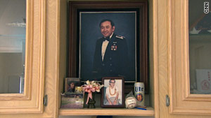 A shrine to Ellison Onizuka in the family's home includes a baseball signed by Buzz Aldrin and Onizuka's favorite beers.