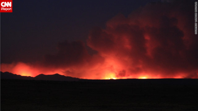 The Las Conchas fire has burned 121,000 acres and destroyed more than 100 buildings, including 63 homes.