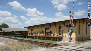 Giddings hopes decorated train depot-style buildings will give travelers a reason to stop and spend.
