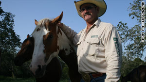 This summer's widespread Texas drought has browned rancher Scot Mitchell's grazing fields.
