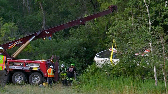 A rescue crew pulls out this bus with a crane after the bus crashed on an interstate in New York, killing two and injuring eight.