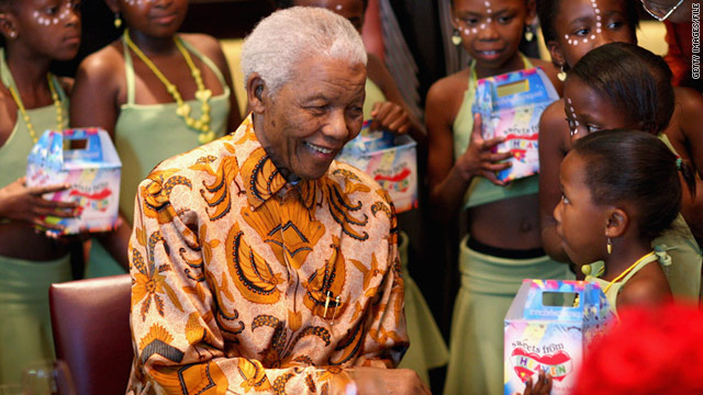 Nelson Mandela greets children in Cape Town, South Africa, in April 2009.