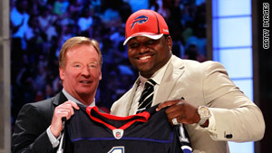 Marcell Dareus with NFL Commissioner Roger Goodell after being selected by the Buffalo Bills in April.