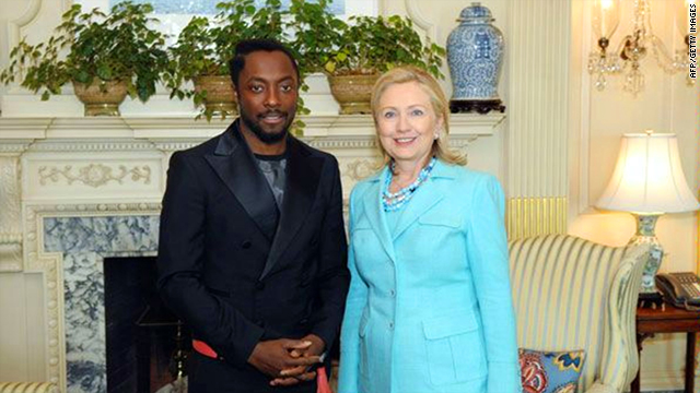 This image released by the U.S. State Department shows Secretary of State Hillary Clinton with musician will.i.am on Friday.