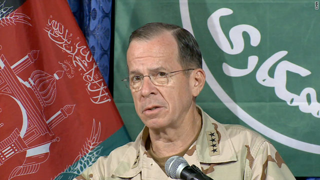 Adm. Mike Mullen talks to reporters Sunday in Kabul, Afghanistan, about troop pay and a possible debt crisis.