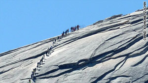 Metal cables help hikers climb Half Dome's final 400 feet.