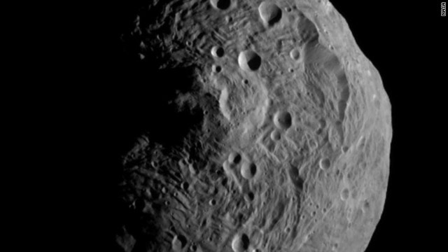 An image of the 330-mile wide asteroid Vesta was taken by Dawn spacecraft from about 3,200 miles away.