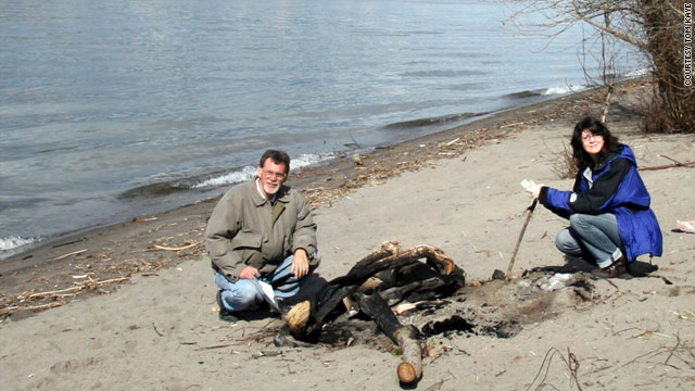 Tom Kaye and a fellow D.B. Cooper hunter, in a 2009 photo, inspect the area where some cash the hijacker took was found.