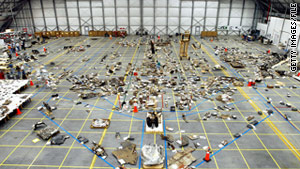 Recovered debris from the space shuttle Columbia lies in a hangar at Kennedy Space Center in May 2003.