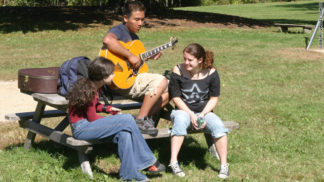 Students chat outside at Sudbury Valley School in Framingham, Massachusetts.