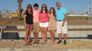 The McAllister family -- Sheri, Locke, Megan, Lydia and Edward -- where their Joplin home used to stand.