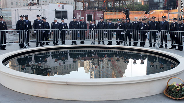 New York City police officers attend last year's September 11 memorial ceremony. First responders are not invited this year.