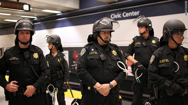 Bay Area Rapid Transit police officers stand guard during a protest at a San Francisco station.